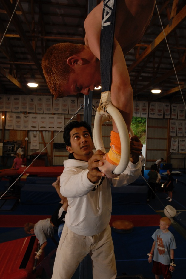 Raj coaching gymnastics